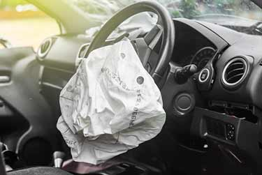 Inside of car with deployed airbag