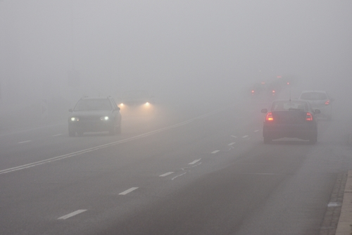 Cars driving on highway in fog