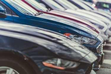 cars lined up on a car lot