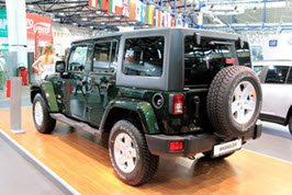 Green Jeep Wrangler in a showroom