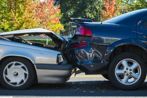 two car damaged cars after rear end collision