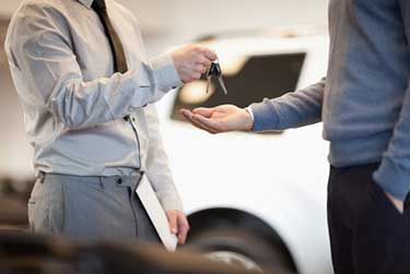 Man handing car keys over
