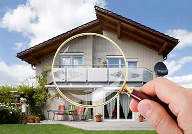 House with a magnifying glass