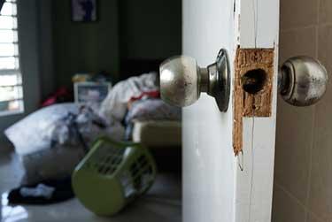 Door damaged from a break in