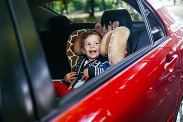 young toddler in a car seat