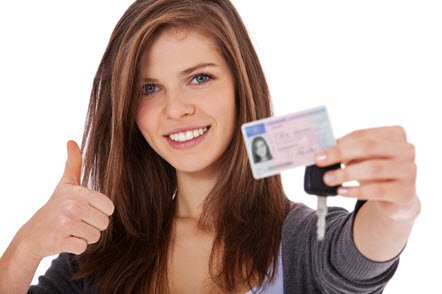 Teenage girl showing her drivers licence and car keys