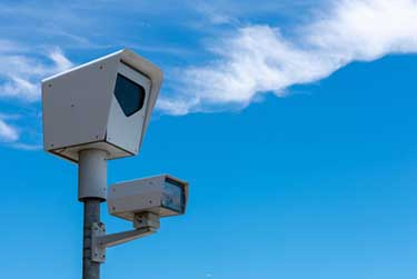 red light camera ticket and insurance