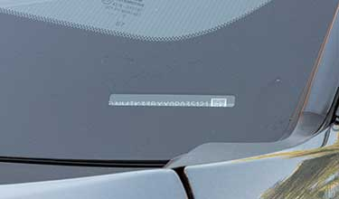 VIN number characters on car dashboard